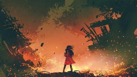 Young mother in red coat carrying her baby standing in the burning city 写真素材