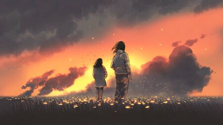 Beautiful scenery of the young couple standing in glowing flowers filed and looking sunset sky