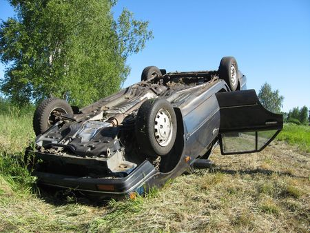 insure: Damaged car after the traffic accident, turned overhead