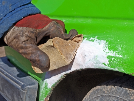 car body: Grinding car body by hand with sand paper
