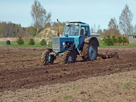harrow: Field harrowing by tractor powered hard disk harrow