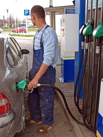fueling: Man, filling the car tank with fuel Stock Photo