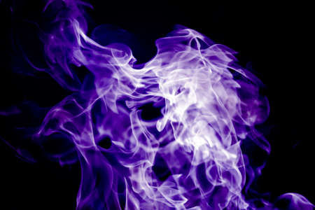 Beautiful violet tongues of flame, fire dance, background texture
