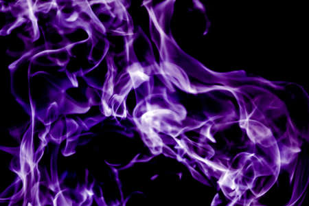 beautiful violet tongues of flame, fire dance, background texture Stock Photo