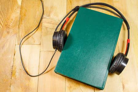book and  headphones background. Stockfoto
