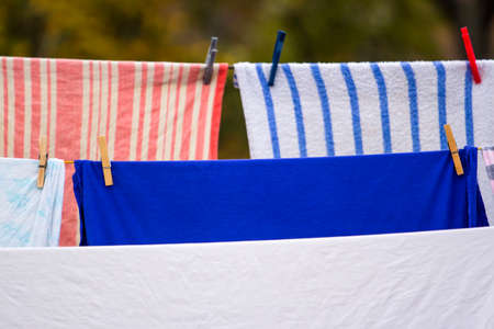 washed laundry dries on a rope in the yard