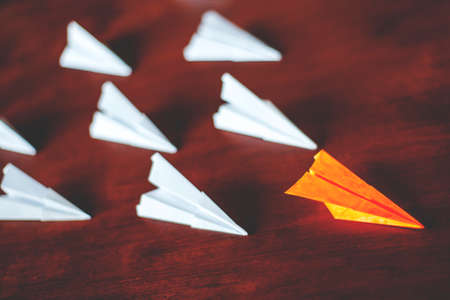 paper self-flying systems, follow the leader, concept, retro toned Stock Photo