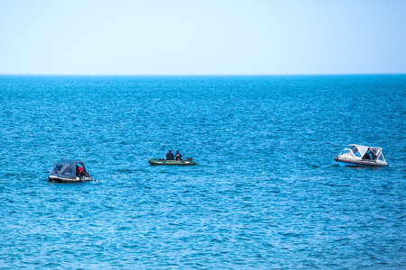 divers in rubber boats in the blue sea Stock Photo