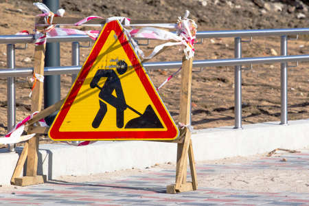 triangular sign of road works