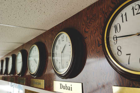 clock with world time on the exchange, retro toned