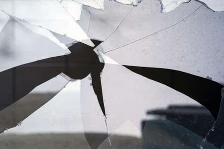 broken glass with a big hole Imagens