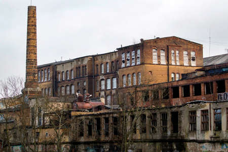 old abandoned factory with a stone pipe in the industrial zone Imagens