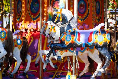 horses on a carousel in an amusement park