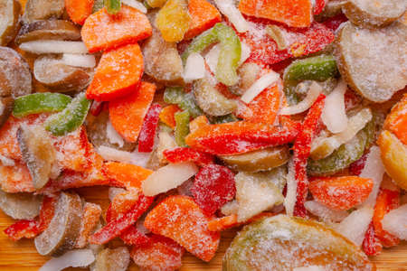 bright colored sliced frozen vegetables, flat lay, background, texture Banque d'images - 110027445