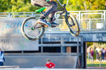 young athlete makes an extreme bike jump on a ramp