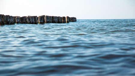 old breakwaters in the sea Standard-Bild - 111996649