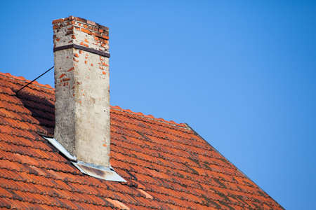 old chimney from the brick of a dilapidated house Stock Photo