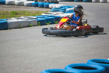 a young boy is riding a karting Stok Fotoğraf