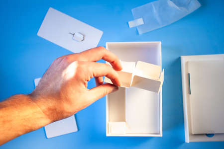unpacked box from a smartphone on a blue background