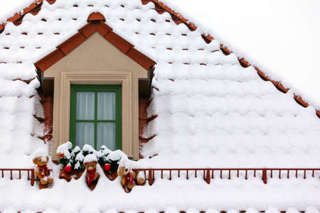 snow-covered roofs of houses Stock Photo