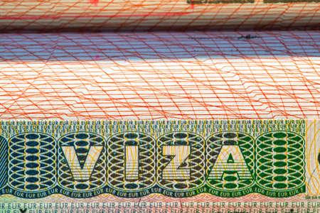 VISA stamp on passport page, marco, background