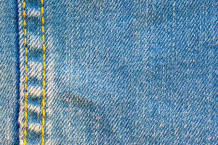 blue denim surface with stitching, background, texture Фото со стока