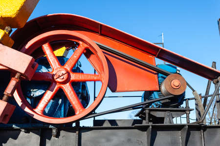 close-up of the massive mechanism on the oil producing tower