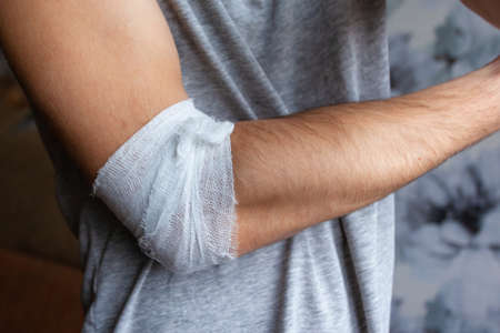 man's arm with bandaged elbow