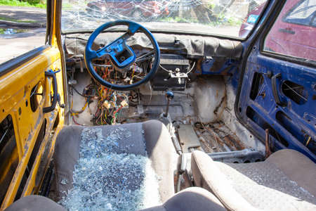 damaged car with broken windows and empty interior