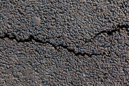 crack on new asphalt, top view, background, texture