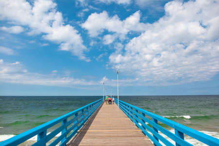 bright wooden pier by the sea on a sunny summer day Stock fotó