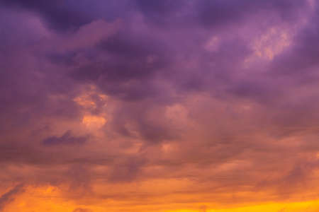 bright gradient clouds of orange and purple at sunset
