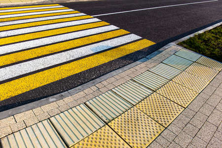 tactile tile for the blind before a pedestrian crossing on a city street