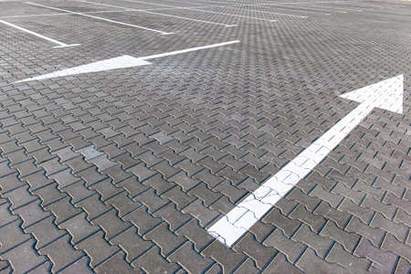 directional arrows on the street parking tile Stock fotó