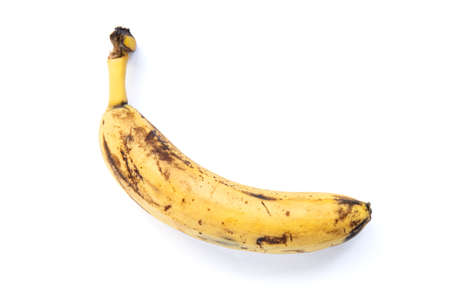 banana with a slightly blackened skin, isolate