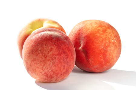 juicy ripe peaches in natural sunlight, isolate