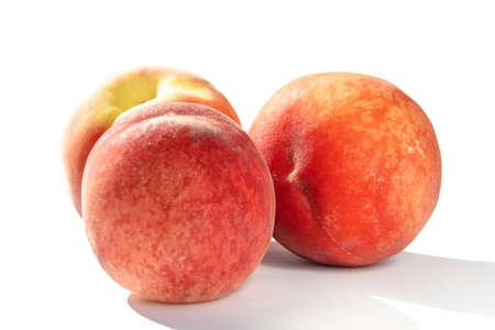 juicy ripe peaches in natural sunlight, isolate Stock fotó - 134718298