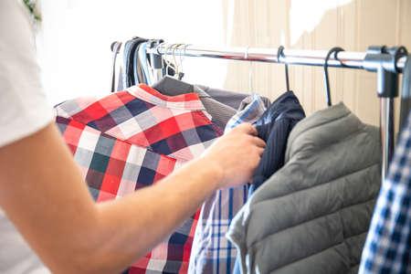 man chooses what shirt to wear Stock fotó - 134718325
