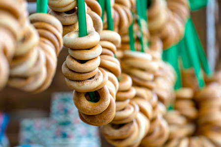 knitted bagels on a rope in the market Stock fotó