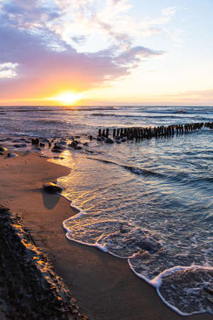 bright soft colors of summer sunset near the sea and beach with breakwaters Stock fotó - 134718365
