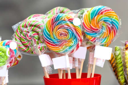 bright colored caramel on a stick Stock Photo