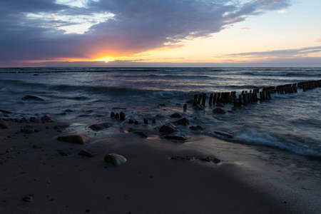 baltic sea with old breakwaters at long shutter speed at sunset Stock fotó - 134718649