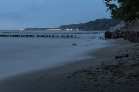 the lights of a small town by the sea in the evening on a long exposure Stock fotó - 134718774