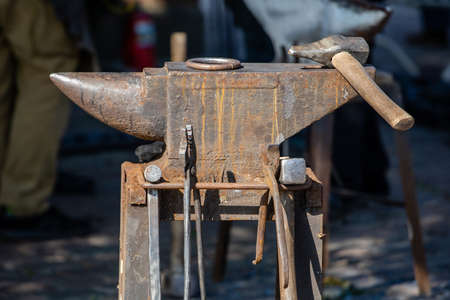 close-up of an old rusty blacksmith anvil with a hammer