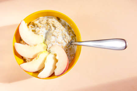 bowl of oatmeal with peach wedges