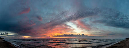 bright picturesque sunset by the sea, panorama