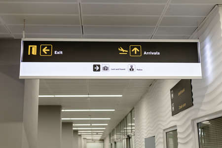 signboard with pointers inside the airport