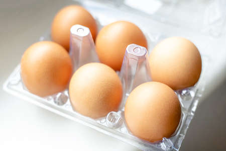 tray with chicken eggs on a light background