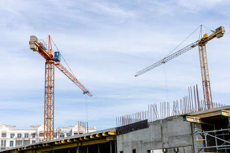 construction cranes on blue sky background