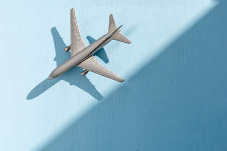 model airplane on a light blue background, copy space 免版税图像